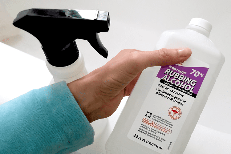 Holding Bottle of Rubbing Alcohol