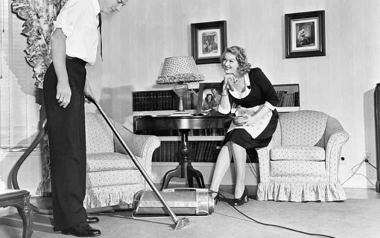 husbaand vacuuming with his wife