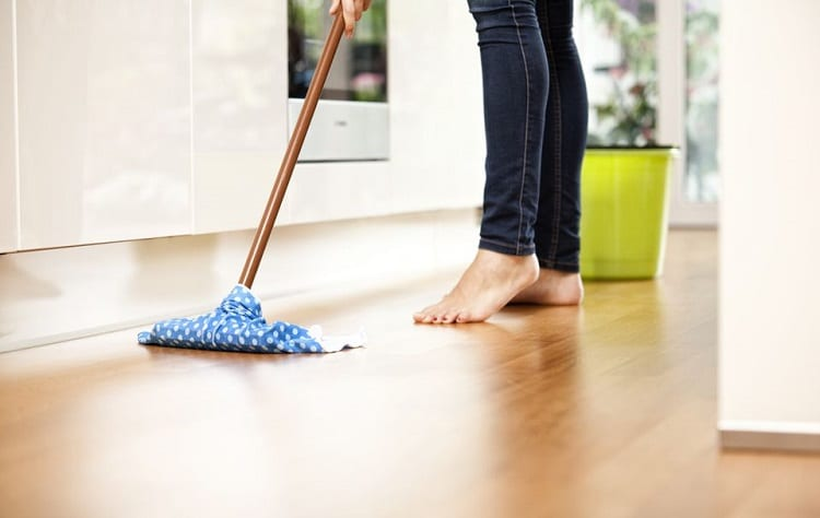 woman cleaning hardwood floor