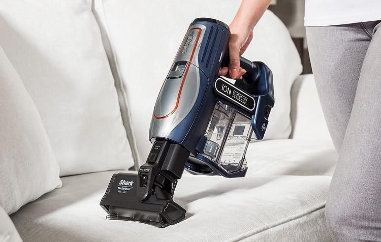 vacuuming sofa