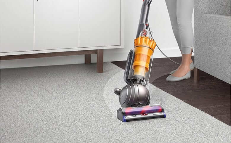woman cleaning with dyson lightball